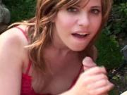 Hot bitch hand massages a hard cock before getting cumshot on the lawn