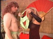 Horny mistress spanks her boy slave dressed in latex