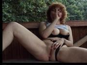 Curly haired redhead milf masturbates outdoors