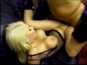 Beautiful blonde anal slut in black mesh lingerie takes a big cock in her anus