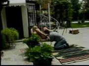 Haggard blonde fucked from behind in backyard