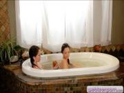 Two cute teens pleasuring in the bathtub