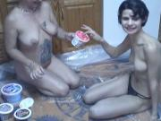 Older and younger lesbians rub food all over each other on the floor