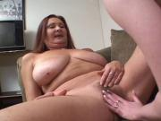 Mature brunette lets young hottie sit on her face