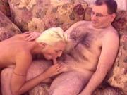 Beautiful blonde whore wraps her lips around guys stiff hard cock