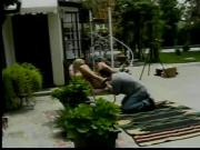 Haggard blonde fucked from behind in backyard