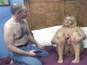 Busty blonde gets pleased by tongue and dildo on the bed