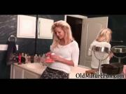 Blond housewife in bathroom does striptease in bra
