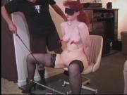Mature redhead gets blindfolded and pussy played with by dominatrix