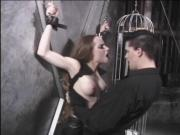 Dark-haired subbie in wrist restraints and nipple clamps punished in BDSM lair