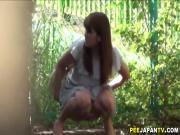 Asian slut pees outside